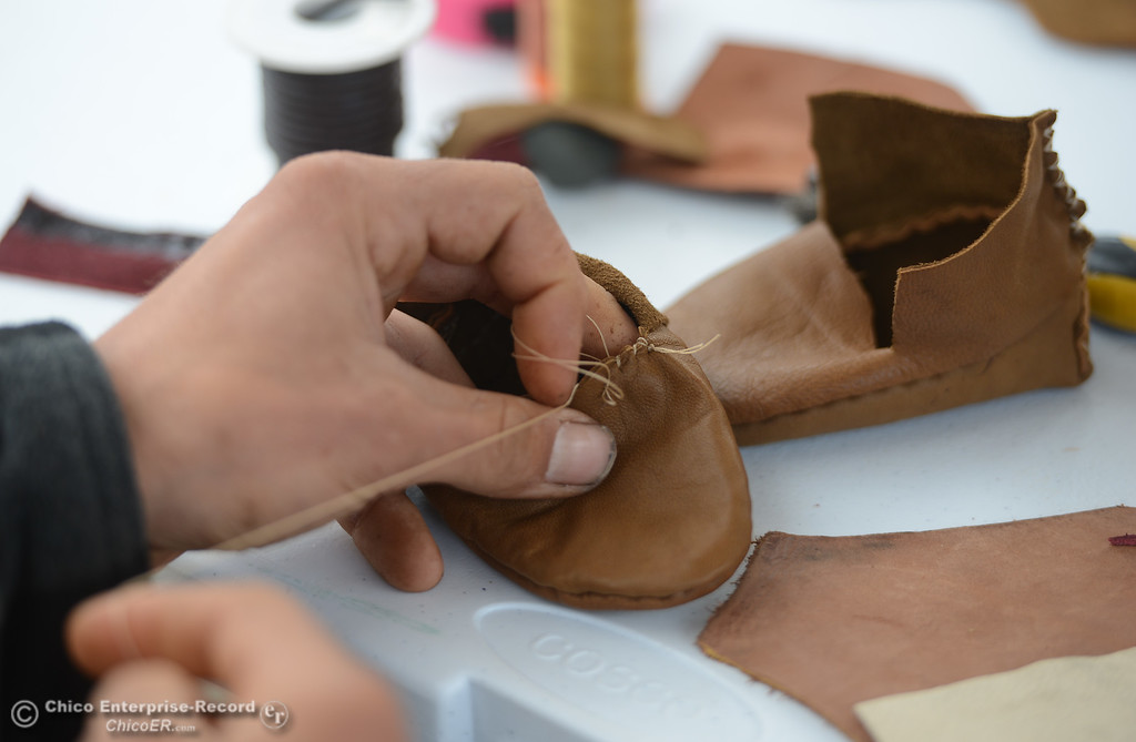 . Ean Greer makes a pair of moccasins for a baby out of leather, Saturday, March 10, 2018, in Chico, California. (Carin Dorghalli -- Enterprise-Record)
