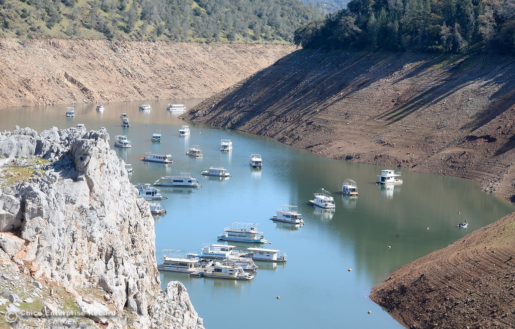 . Houseboats float in an arm of Lake Oroville near Lime Saddle Marina Monday March 5, 2018. (Bill Husa -- Enterprise-Record)