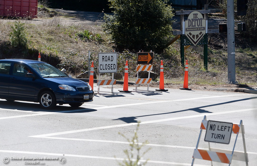 . Vehicles are turned onto Old Skyway at the Coutolenc Road intersection of New Skyway and Old Skyway as construction is underway Tues. March 6, 2018. (Bill Husa -- Enterprise-Record)