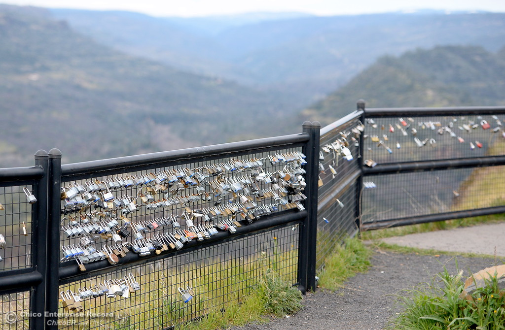 """. Locks of every shape, size, brand and style have been accumulating on the barrier fence at Lookout Point since shortly after the fence was erected. They\'ve been known as \""""Locks of Love\"""" or \""""Love Locks\"""" by some. Many are marked with messages or decorated in one way or another dedicated to a lover, a friend or a relative who has passed. (Bill Husa -- Enterprise-Record)"""