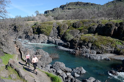 Madi Fremont and Brandon Sovik of Chico enjoy a hike near Bear Hole in Upper Bidwell Park Wednesday March 1, 2017. (Bill Husa -- Enterprise-Record)