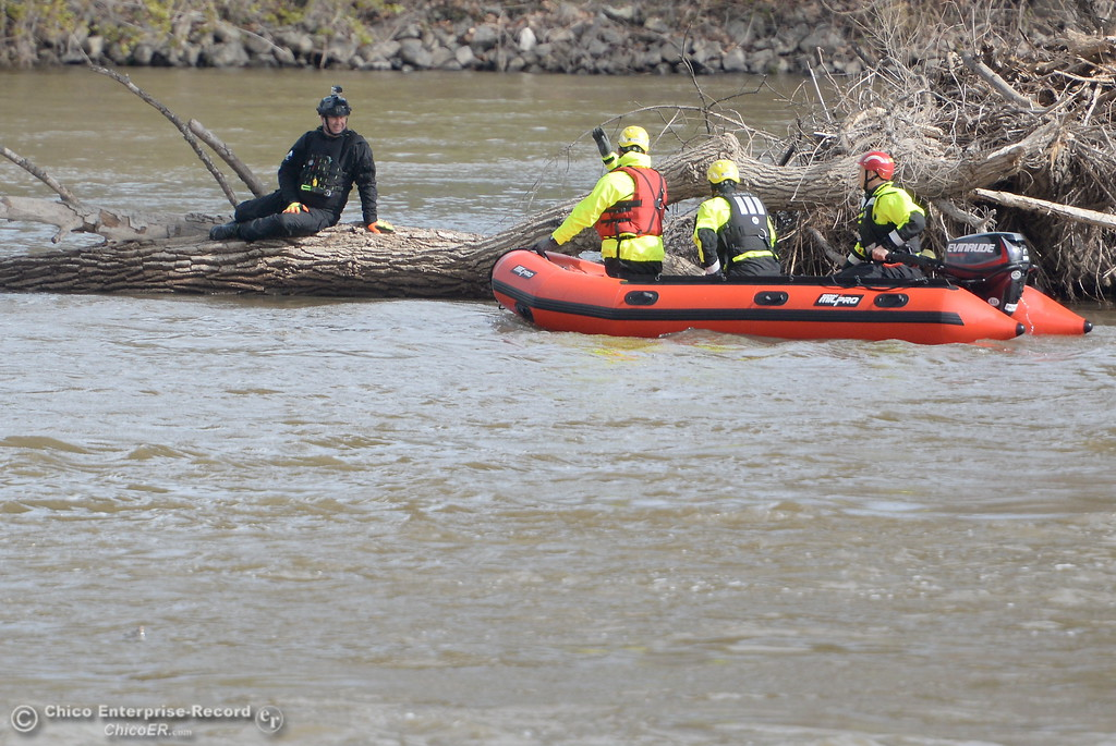 . Jeremy Edmonds of Asheville North Carolina plays the role of a victim stranded on a log as fire and rescue workers from across the country participate in water rescue training on the Sacramento River near Irvine Finch Wed. March 14, 2018. International Association of Water Rescue Professionals President Dave Abt said there were about 19 facilitators and roughly 50 attendees from across the country participating in today\'s training.  (Bill Husa -- Enterprise-Record)