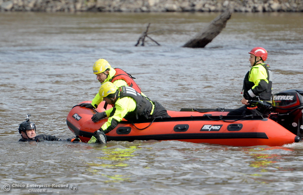 . Jeremy Edmonds of Asheville North Carolina plays the role of a victim floating in the water as fire and rescue workers from across the country participate in water rescue training on the Sacramento River near Irvine Finch Wed. March 14, 2018. International Association of Water Rescue Professionals President Dave Abt said there were about 19 facilitators and roughly 50 attendees from across the country participating in today\'s training.  (Bill Husa -- Enterprise-Record)