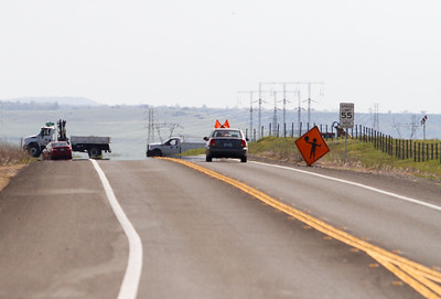 Construction signs warn of one lane roads ahead along Durham-Pentz Road near Highway March 14, 2017  in Chico, California. (Emily Bertolino -- Enterprise-Record)
