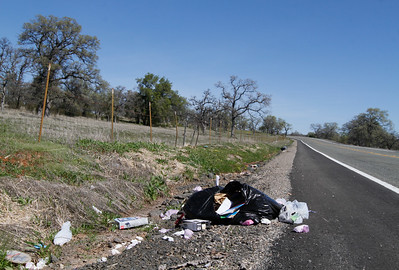 Trash lays strewn along Neal Road March 13, 2017 in Paradise, California. Come on people, I've been seeing way to much trash just ditched on the side of roads around Butte County. (Emily Bertolino -- Enterprise-Record)
