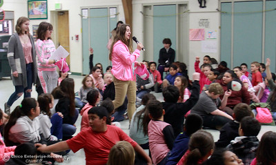 Standing left to right, Pleasant Valley seniors Cara Burditt, Sarah Katris-Tyler and Savannah Banuelos go around the McManus School multipurpose room, asking students to tell them about acts of kindness Wednesday, Feb. 28, 2018, in Chico, California. (Dan Reidel -- Enterprise-Record)
