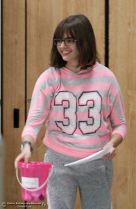 """Sarah Katris-Tyler shows off a """"kindness bucket"""" Wednesday, Feb. 28, 2018, as she and other Pleasant Valley seniors talk about kindness with McManus School students in Chico, California. (Dan Reidel -- Enterprise-Record)"""