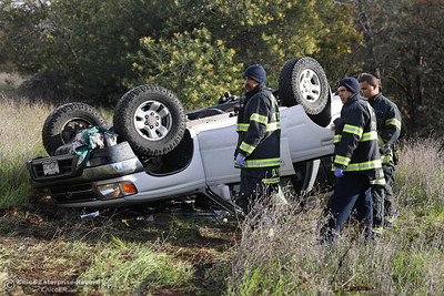 A car rolls over off of Lincoln Blvd., Thursday, March 1, 2018, in Oroville, California. (Carin Dorghalli -- Enterprise-Record)