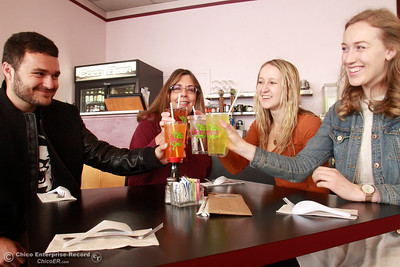 Linda Storey, left center, owner of Hula's Chinese Bar-B-Q has been working with Chico State interns, from left to right, Landon Akhtar, Emily Hilbers and Sophia Graves to help eliminate plastic straws. The four are seen Wednesday, Feb. 28, 2018, using the paper straws while posing for a picture at the restaurant on the 2500 block of the Esplanade in Chico, California. (Dan Reidel -- Enterprise-Record)