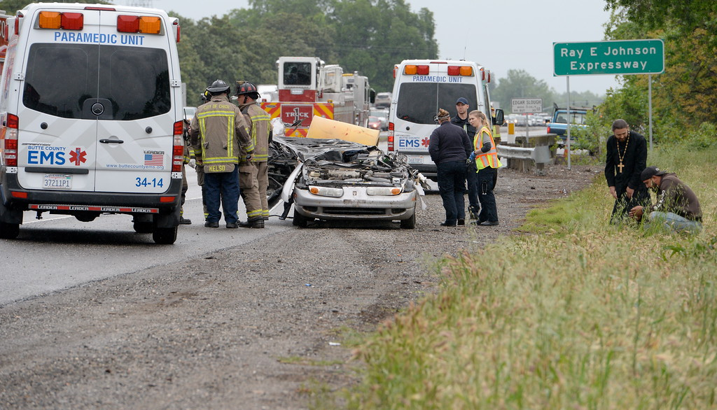 . EMS medics declare one man dead after a trailer being towed by a pickup came off and traveled across the center divide of Hwy. 99 striking a silver Saturn Tues. April 11, 2017. Four vehicles appeared to be involved in the collision.  (Bill Husa -- Enterprise-Record)