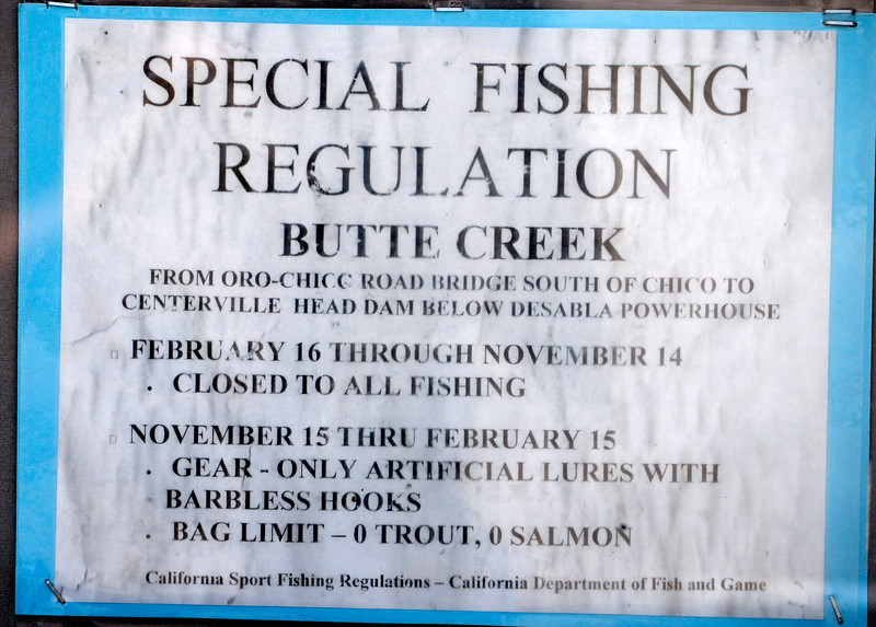 Fishing regulations for Butte Creek are posted on an information board near the Centerville Bridge over Butte Creek in Butte Creek Canyon Monday April 10, 2017.  (Bill Husa -- Enterprise-Record)
