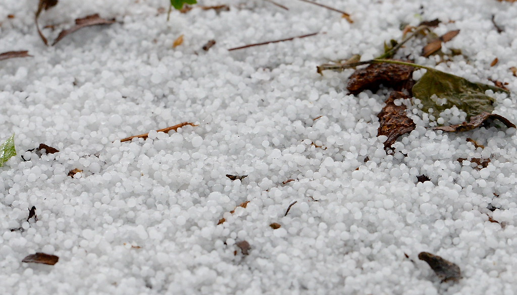 . Hail piles up on the streets of Chico during a thunderstorm in Chico, Calif. Thurs. April 13, 2017. (Bill Husa -- Enterprise-Record)