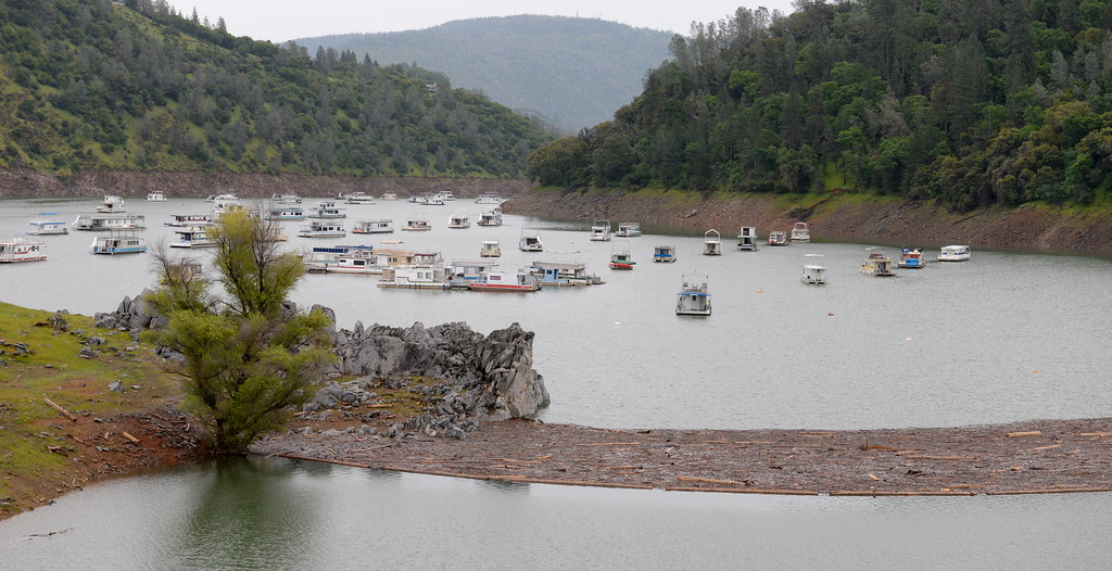 . A log boom holds debris at Lake Oroville seen here near the Forever Resorts Limesaddle Marina Tuesday April 11, 2017.  (Bill Husa -- Enterprise-Record)