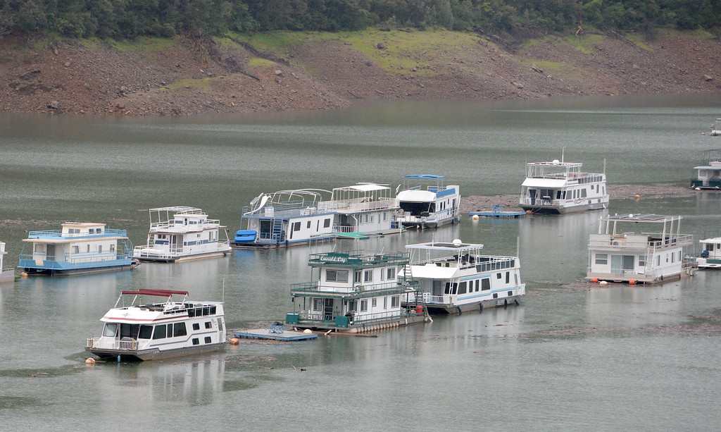 . Houseboats float on Lake Oroville near the Forever Resorts Limesaddle Marina Tuesday April 11, 2017. (Bill Husa -- Enterprise-Record)
