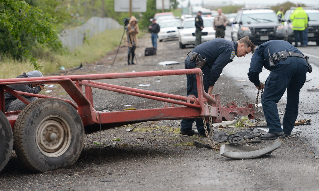 . CHP Officers investigate the scene after a trailer being towed by a pickup came unhitched and traveled across the center divide of Hwy. 99 striking a silver Saturn Tues. April 11, 2017. Four vehicles appeared to be involved in the collision and one man was pronounced dead at the scene.  (Bill Husa -- Enterprise-Record)