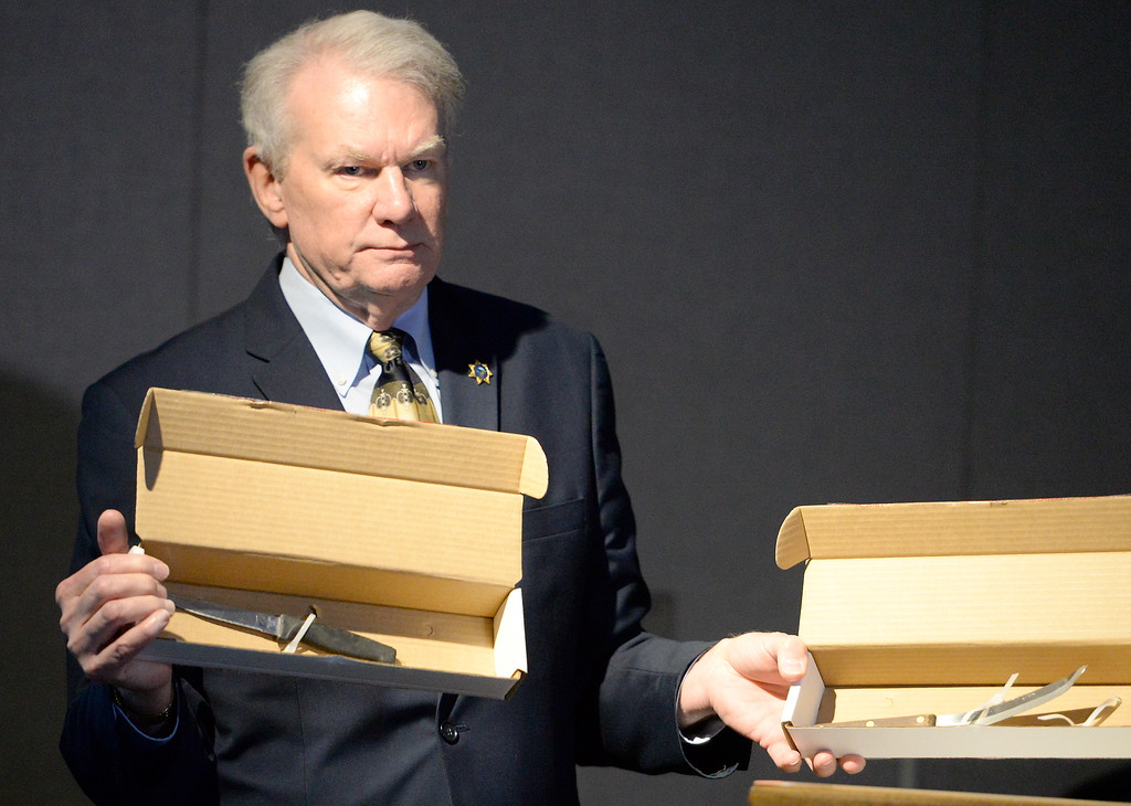 . Butte County District Attorney Mike Ramsey holds the knives that Phillips alledgedly wielded as he talks to media about the Desmond Pillips case during a press conference in Chico, Calif. Thurs. April 13, 2017. (Bill Husa -- Enterprise-Record)