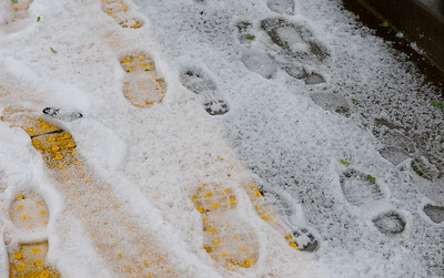 Footprints are made in the hail during a thunderstorm in Chico, Calif. Thurs. April 13, 2017. (Bill Husa -- Enterprise-Record)