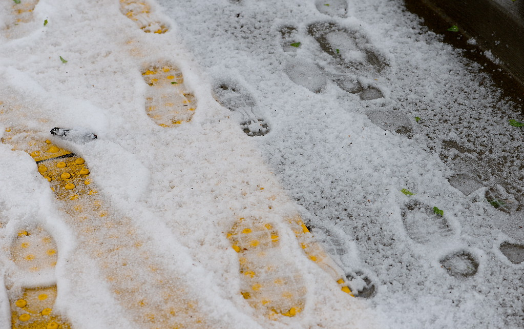 . Footprints are made in the hail during a thunderstorm in Chico, Calif. Thurs. April 13, 2017. (Bill Husa -- Enterprise-Record)