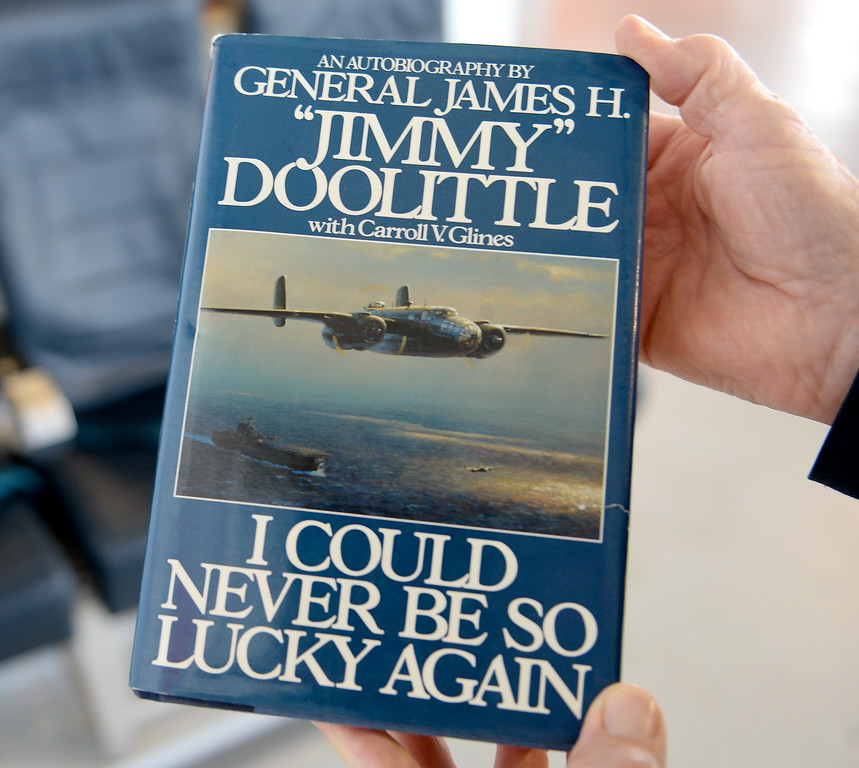 """. Volunteer Bob Tate holds an Autobiography of General James H. \""""Jimmy Doolittle\"""" as he talks about his admiration for the late Jimmy Doolittle at the Chico Air Mueum in Chico, Calif. Thurs. April 13, 2017. (Bill Husa -- Enterprise-Record)"""