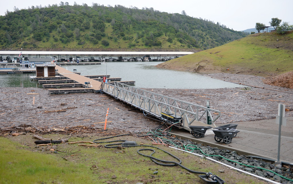 . Lake Oroville is open for recreation despite debris piles near the launch ramp at Forever Resorts Limesaddle Marina Tuesday April 11, 2017. Floating debris seems a bit more than usual and is likely due to runnoff and the rising, falling of the lake levels during this wet winter. (Bill Husa -- Enterprise-Record)