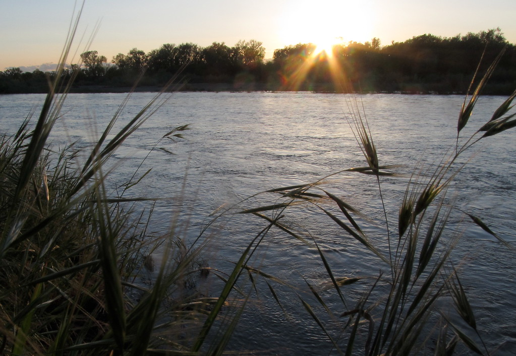 . The sun sets behind the Sacramento River near the Woodson Bridge State Recreation Area Saturday April 8, 2017. (Bill Husa Photo)