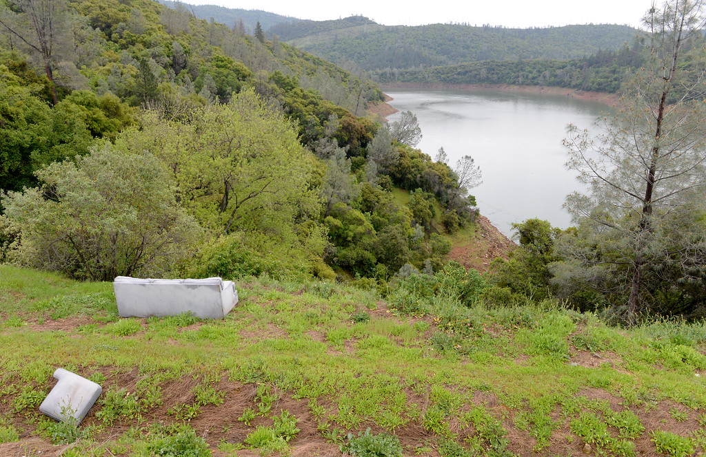 . A discarded couch sits along the shore of Lake Oroville near the Hwy. 70 bridge over the West Branch seen near the Forever Resorts Limesaddle Marina Tuesday April 11, 2017. (Bill Husa -- Enterprise-Record)
