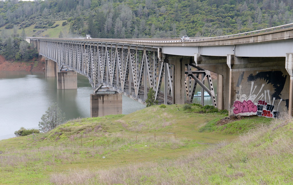. Vehicles cross over the West Branch of Lake Oroville along the Hwy. 70 bridge Tuesday April 11, 2017. (Bill Husa -- Enterprise-Record)