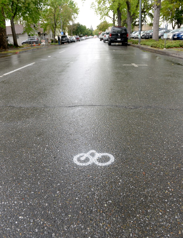 . Markings for an experimental bike lane are seen on the asphalt along 3rd Street as the rain comes down in Chico, Calif. Monday April 16, 2018. (Bill Husa -- Enterprise-Record)