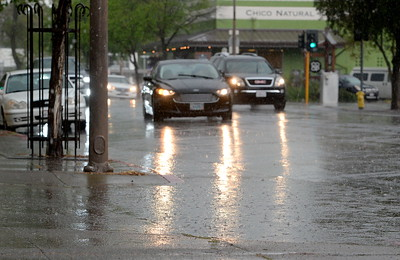 Drivers make their way through heavy rain and hail along Main Street in downtown Chico, Calif. Monday April 16, 2018. (Bill Husa -- Enterprise-Record)