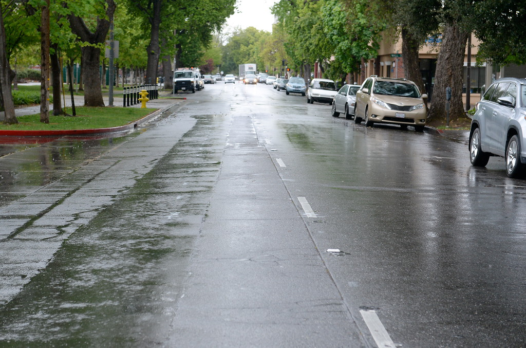 . Markings for a bike lane are seen along 4th Street as the rain comes down in Chico, Calif. Monday April 16, 2018. (Bill Husa -- Enterprise-Record)