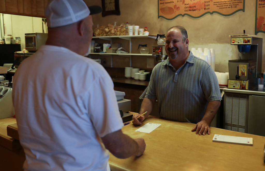 . La Comida Mexican Restaurant turns 50 this year. Owner Michael Pavis Jr. assists Nobby Noblett from behind the counter, April 19, 2018, in Chico, California. (Carin Dorghalli -- Enterprise-Record)