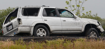 A Toyota 4Runner is seen with all of the windows shattered following a rollover accident on Hwy. 99 near the Southbound 99 onramp at East Ave. in Chico, Calif. Monday April 16, 2018. (Bill Husa -- Enterprise-Record)