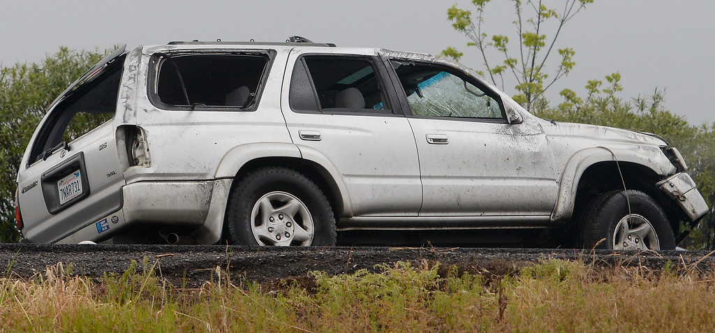 . A Toyota 4Runner is seen with all of the windows shattered following a rollover accident on Hwy. 99 near the Southbound 99 onramp at East Ave. in Chico, Calif. Monday April 16, 2018. (Bill Husa -- Enterprise-Record)