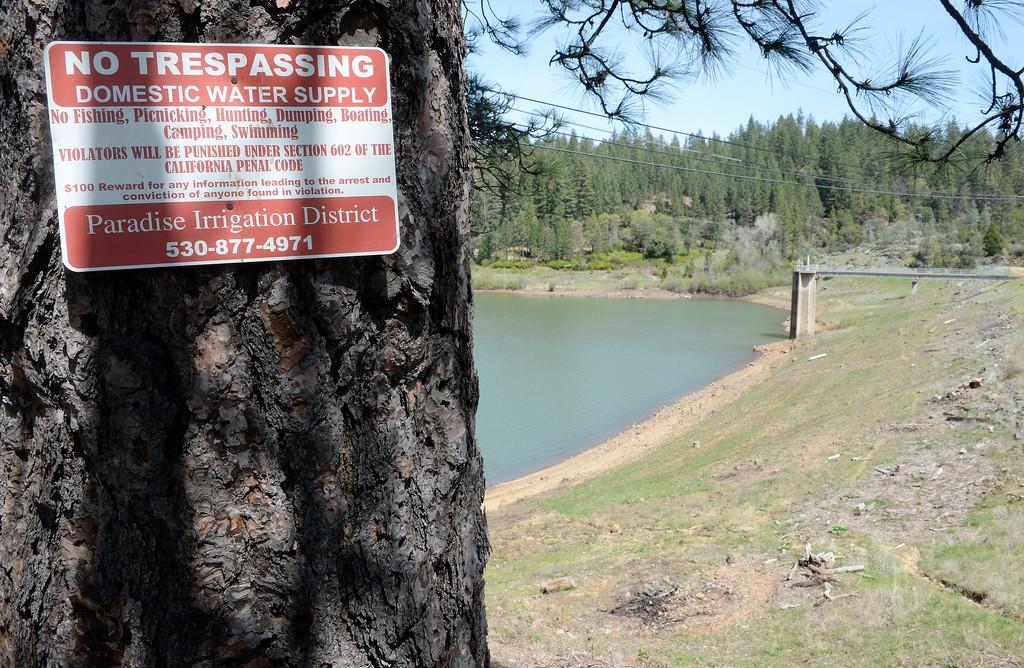 . A no trespassing sign is seen at the Magalia Reservoir in Paradise, Calif. Friday April 13, 2018. (Bill Husa -- Enterprise-Record)