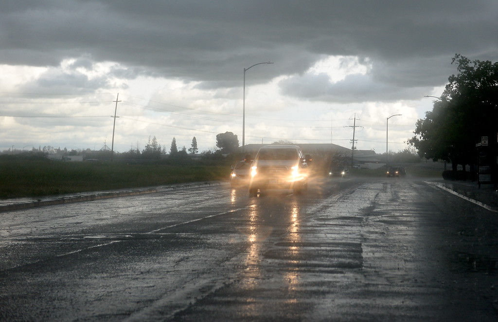 . Drivers make their way through heavy rain and hail along Dr. Martin Luther King Jr. Parkway beneath a big, black cloud over Chico, Calif. Monday April 16, 2018. (Bill Husa -- Enterprise-Record)