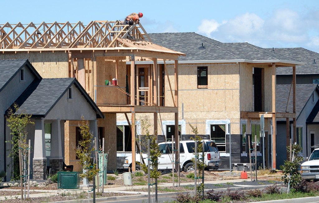 . Construction is seen on residential housing near Eaton Road in Chico, Calif. Tues. April 17, 2018.  (Bill Husa -- Enterprise-Record)