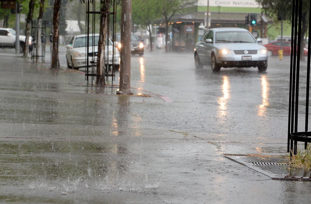 . Drivers make their way through heavy rain and hail along Main Street in downtown Chico, Calif. Monday April 16, 2018. (Bill Husa -- Enterprise-Record)