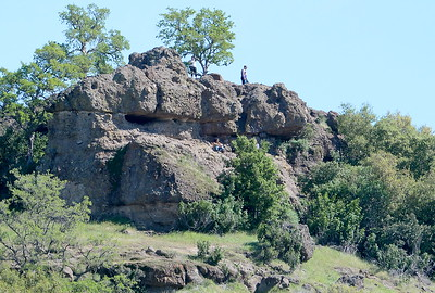 Hikers enjoy the green grass and blooming wildflowers in Upper Bidwell Park near Monkey Face rock Tues. March 28, 2017. (Bill Husa -- Enterprise-Record)