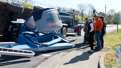 Traffic was snarled but no injuries were reported after a truck towing a trailer with a Rental Guys lift on it flipped onto it's side near the intersection of East Ave. and Hwy. 32 Tues. March 28, 2017. (Bill Husa -- Enterprise-Record)