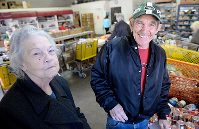 President Pat Smith left and Vice President Frank Langley smile during food distribution day at the Butte County Gleaners distribution center on Nord Ave. in Chico, Calif. Tues. March 28, 2017. (Bill Husa -- Enterprise-Record)
