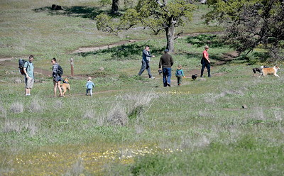 Hikers enjoy the green grass and blooming wildflowers in Upper Bidwell Park near Horseshoe Lake Tues. March 28, 2017. (Bill Husa -- Enterprise-Record)