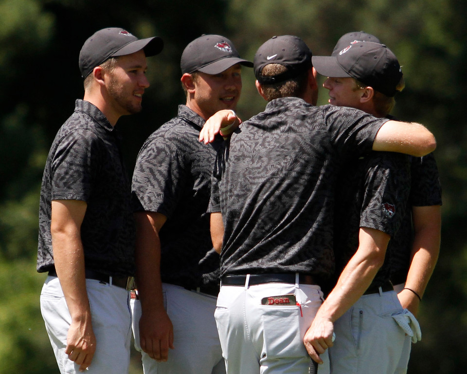 . The Chico State mens golf team congratulates each other after defeating Cal State Monterey Bay in match play Wednesday, April 25, 2018, for the California Collegiate Athletic Association championship at the Butte Creek Country Club in Chico, California. (Dan Reidel -- Enterprise-Record)