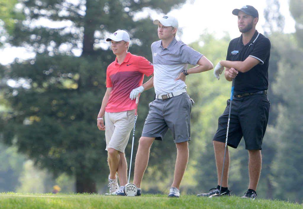 . CSUC\'s Kelly Sullivan, at left beside ---- during CSUC Men\'s CCAA Championship golf at Butte Creek Country Club in Chico, Calif. Tues. April 24, 2018. (Bill Husa -- Enterprise-Record)