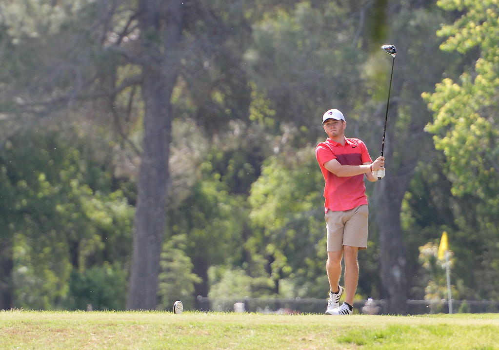 . Colby Dean watches his drive off of the 9th hole tee during CSUC Men\'s CCAA Championship golf at Butte Creek Country Club in Chico, Calif. Tues. April 24, 2018. (Bill Husa -- Enterprise-Record)