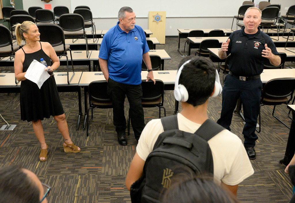 . Chico Firefighter Ken Smith talks about oppotunities in Firefighting and Law Enforcement as more than 450 students in grades 4-8 tour the Butte College Campus during kids challenge day in Chico, Calif. Tues. April 24, 2018. Students learned about various programs offered at the college and in some case, how much money they might expect to make with certain careers.  (Bill Husa -- Enterprise-Record)