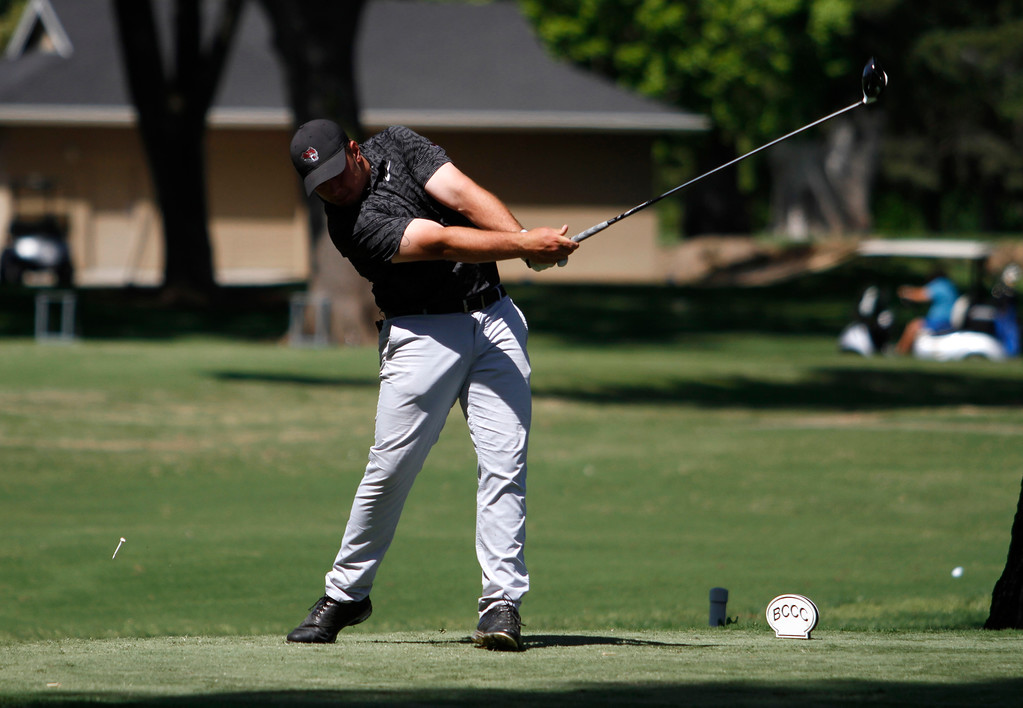 . Serge Kiriluk tees off on the 15th hole as the Chico State mens golf team faces Cal State Monterey Bay in match play Wednesday, April 25, 2018, for the California Collegiate Athletic Association championship at the Butte Creek Country Club in Chico, California. (Dan Reidel -- Enterprise-Record)