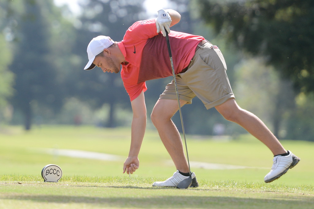. Chris Colla picks up his tee during CSUC Men\'s CCAA Championship golf at Butte Creek Country Club in Chico, Calif. Tues. April 24, 2018. (Bill Husa -- Enterprise-Record)