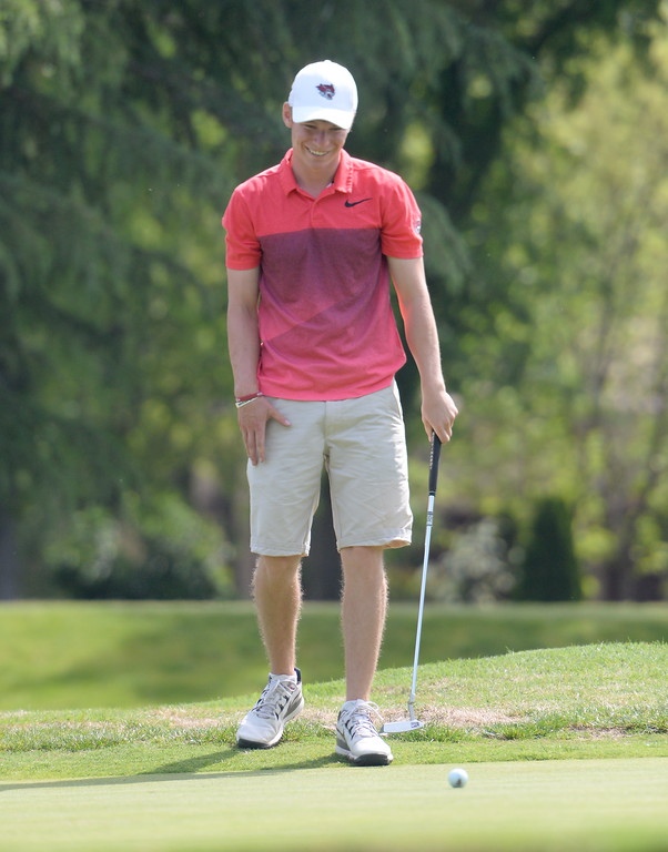 . Kelly Sullivan cracks a smile on the 8th hole green during CSUC Men\'s CCAA Championship golf at Butte Creek Country Club in Chico, Calif. Tues. April 24, 2018. (Bill Husa -- Enterprise-Record)