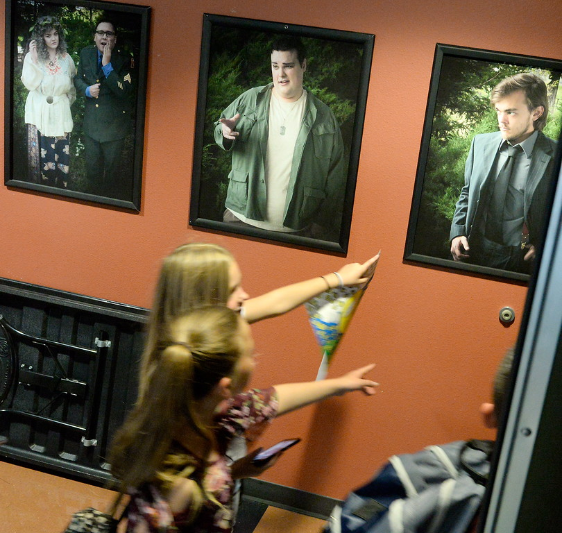 . A group walks past portraits of actors as they tour the Art\'s building during kids challenge day in Chico, Calif. Tues. April 24, 2018. Students learned about various programs offered at the college and in some case, how much money they might expect to make with certain careers.  (Bill Husa -- Enterprise-Record)