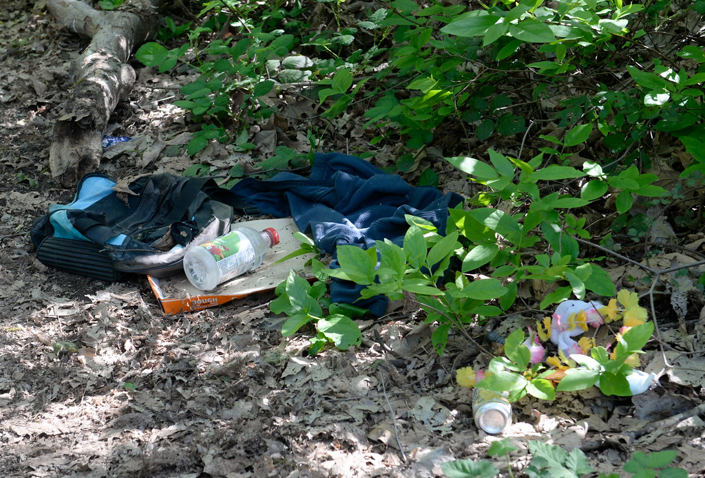 . Garbage litters the woods along Big Chico Creek in lower Bidwell Park in Chico, Calif. Monday April 23, 2018. (Bill Husa -- Enterprise-Record)